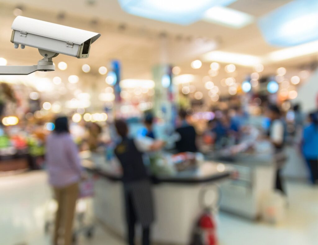 indoor security camera with cashiers and shoppers in background