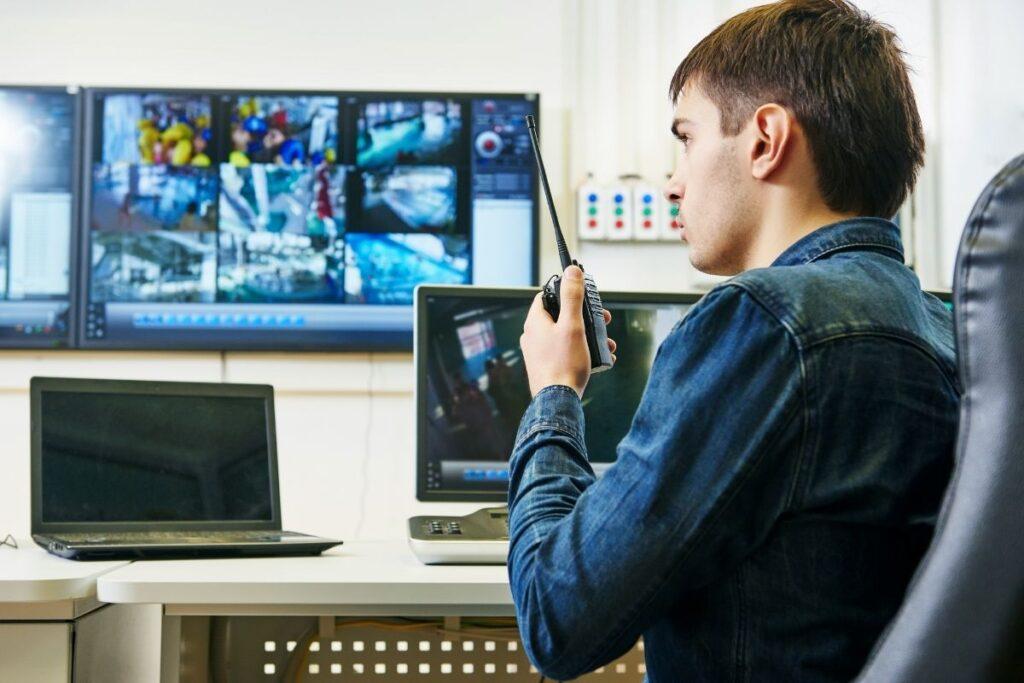 Person monitoring video surveillance screens