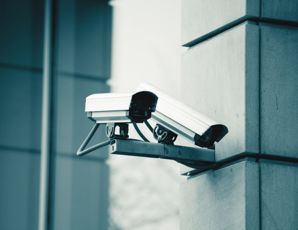 two security cameras on side of building